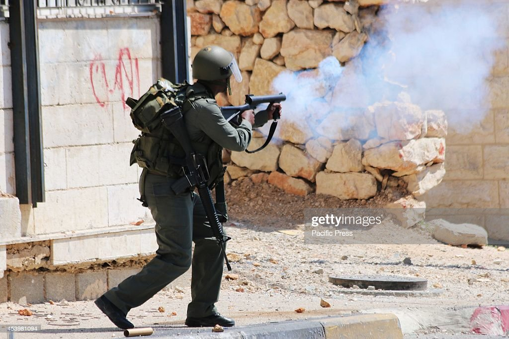 An Israeli soldier shoots a tear gas canister into a crowd of Palestinian protesters. The Islamic Jihad faction organized protests in solidarity with Gaza, in the West Bank city of Bethlehem. As ceasefire talks collapsed completely in Cairo earlier this week, and fighting renewed on Wednesday. Hamas launched a barrage of rockets towards Southern Israel, some reaching as far as Jerusalem and illegal Israeli settlements in the West Bank, some 80 kilometers away from Gaza. Late Tuesday evening an Israeli missile struck the home of Hamas military commander Muhammad Deif, killing his wife and three-year-old daughter. Deif, according to Hamas reports was not assassinated. On Thursday, three more to military commanders, Muhammad Abu Shammala, Raed al-Attar and Muhammad Barhoum were also killed in airstrikes. In response, Hamas killed what they believed to be collaborators with Israel in Gaza. 18 suspected of having worked with Israeli army intelligence have been killed so far. Late Friday afternoon, a four-year-old Israeli child from Nihal Oz was killed by mortar fire from Gaza. To date, the death toll from the Gaza war stands at 2090 Palestinians and 67 Israelis.