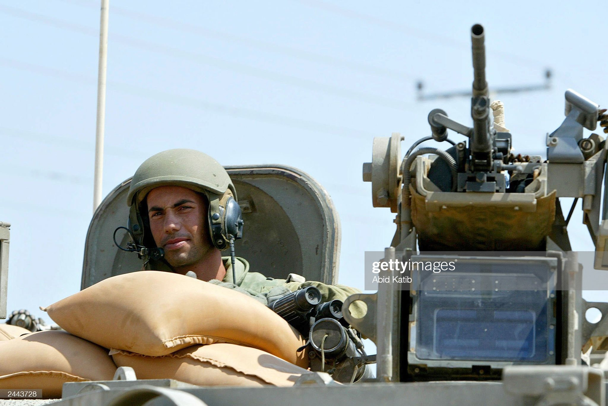 https://media.gettyimages.com/photos/an-israeli-soldier-sits-in-a-tank-while-its-entering-the-erez-29-picture-id2443728?s=2048x2048
