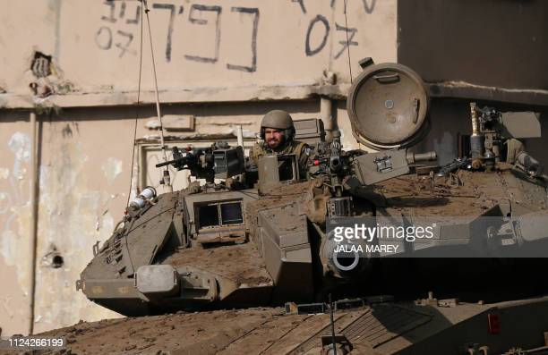 An Israeli soldier sits in an army Merkava tank during a military drill in the Israeliannexed Golan Heights on February 12 2019