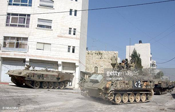 An Israeli soldier sits in his APC in the West Bank city of Ramallah Wednesday March 12 2002