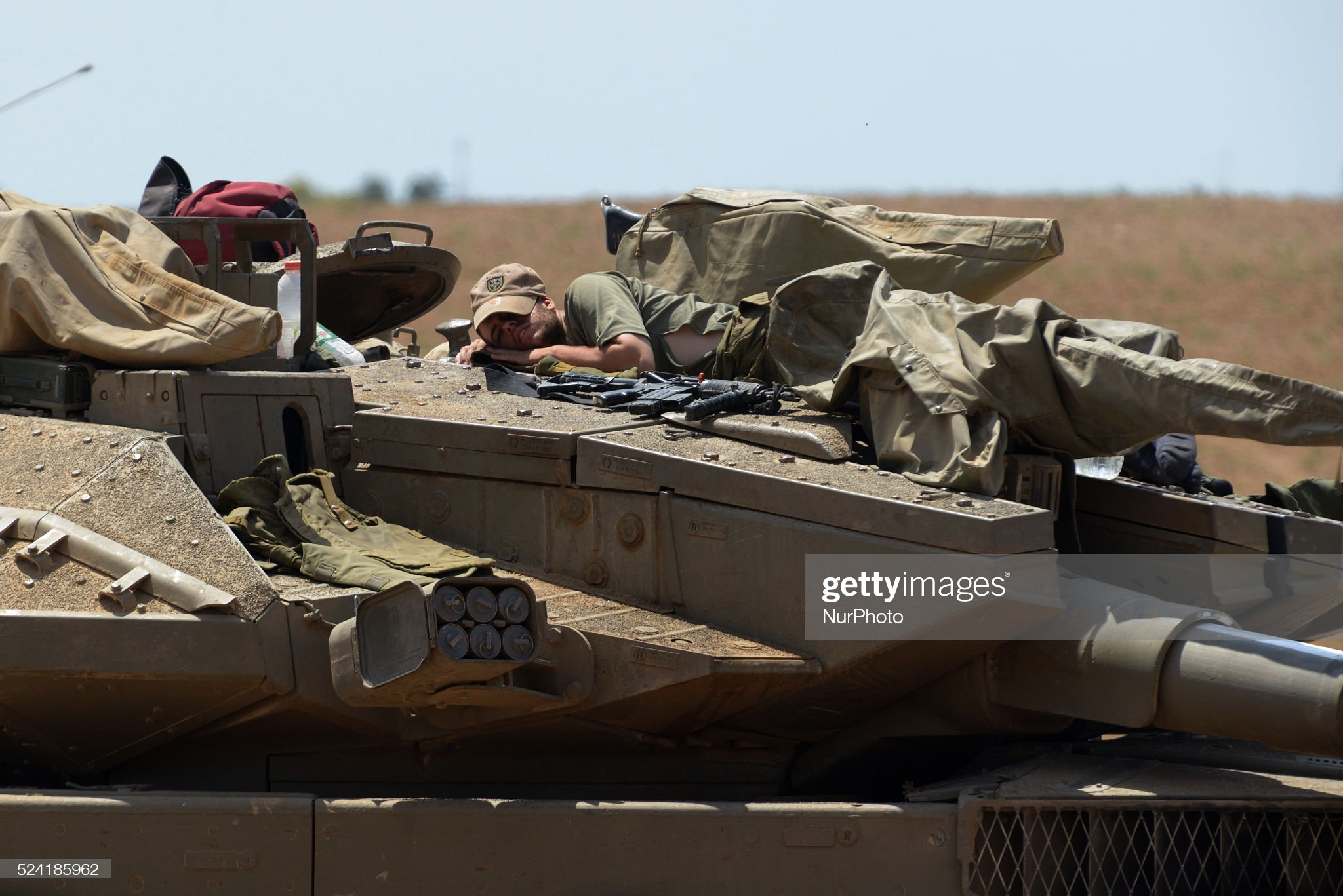 https://media.gettyimages.com/photos/an-israeli-soldier-sleeps-atop-a-tank-in-an-army-deployment-area-near-picture-id524185962?s=2048x2048