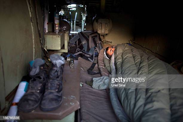 An Israeli soldier sleeps in a deployment area on November 21 2012 on Israel's border with the Gaza Strip Despite widespread rumours of a ceasefire...