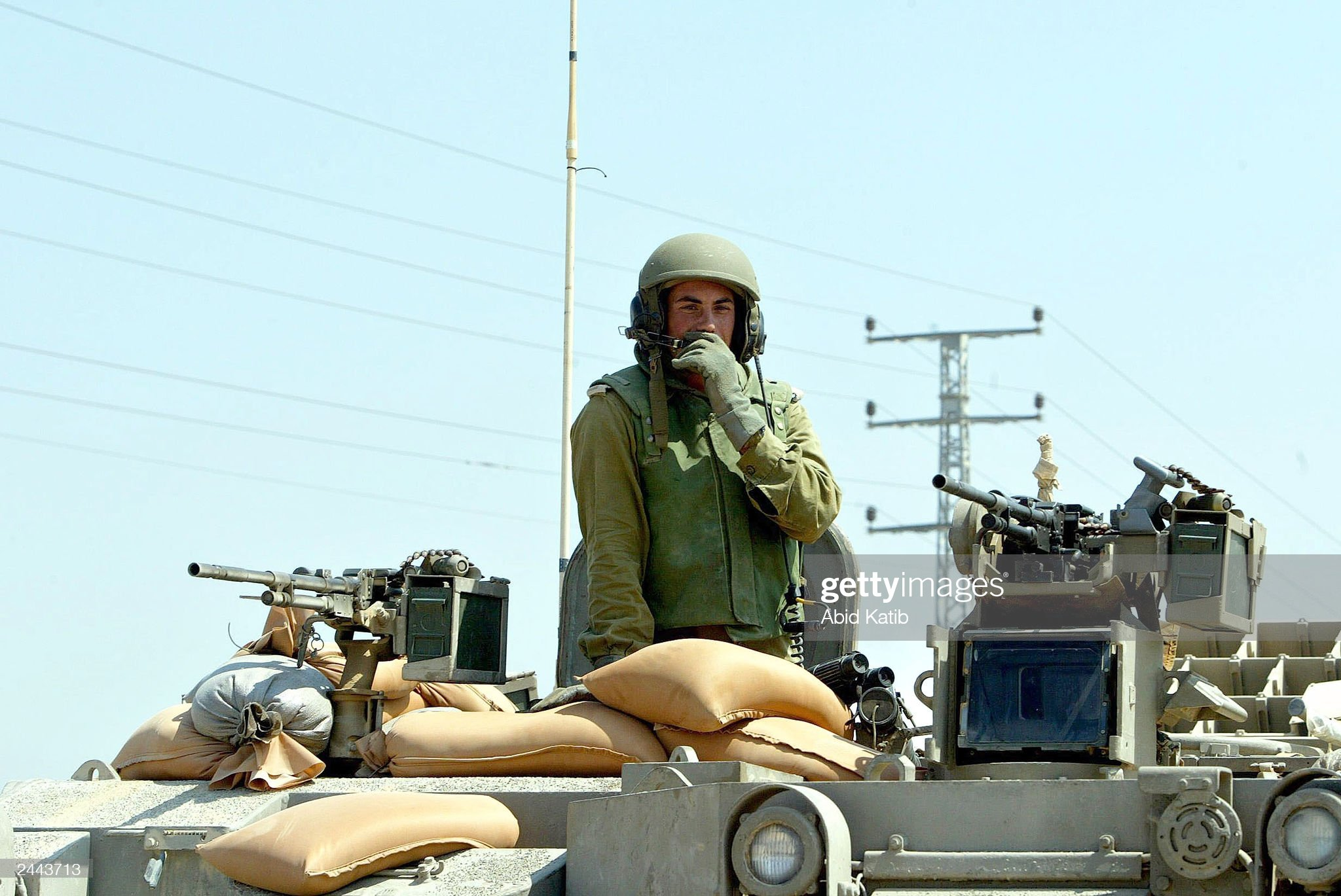 https://media.gettyimages.com/photos/an-israeli-soldier-speaks-into-his-radio-as-he-sits-on-his-tank-while-picture-id2443713?s=2048x2048