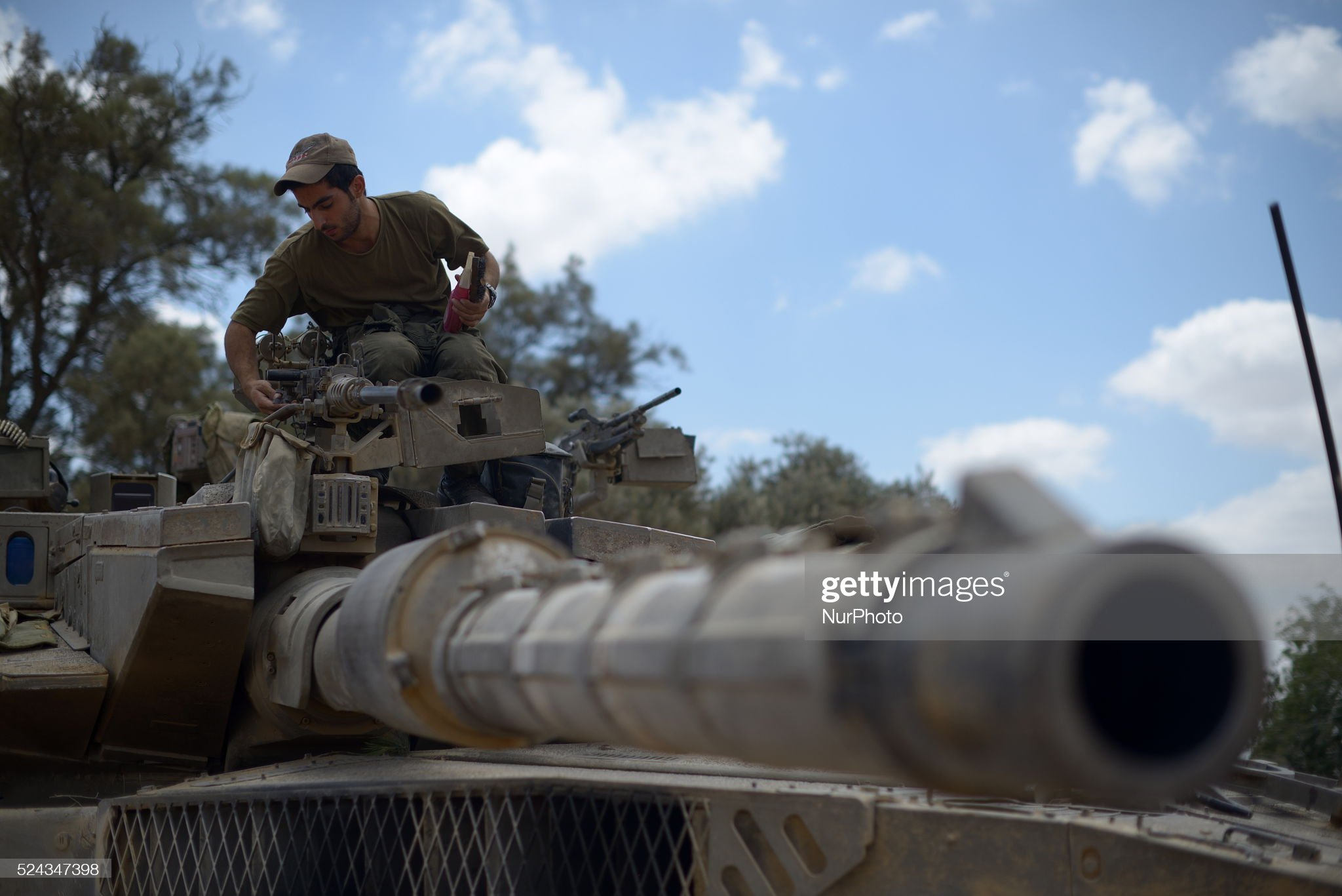 https://media.gettyimages.com/photos/an-israeli-soldier-stands-atop-a-merkava-tank-at-an-army-deployment-picture-id524347398?s=2048x2048