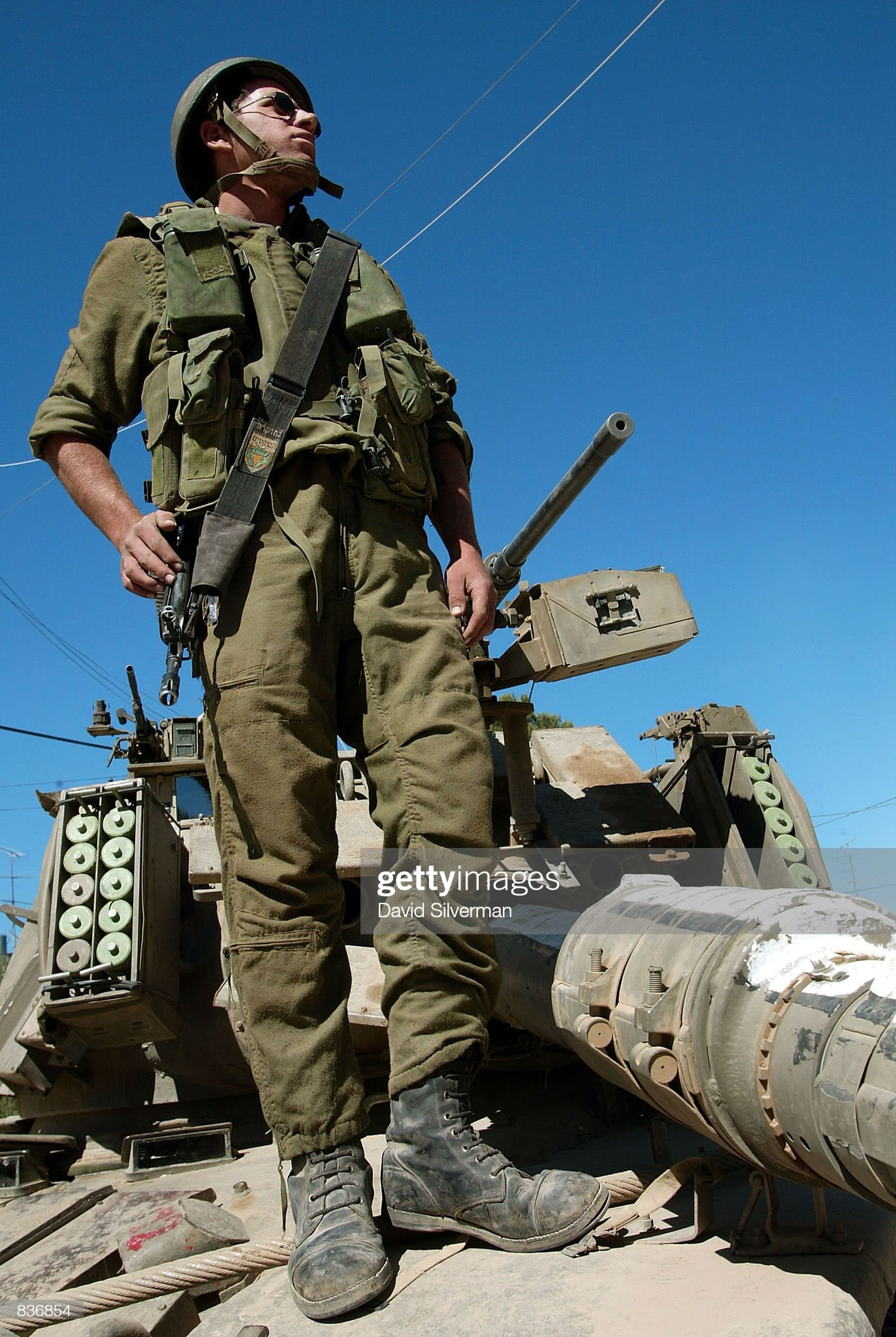 https://media.gettyimages.com/photos/an-israeli-soldier-stands-on-his-tank-outside-palestinian-leader-picture-id836854?s=2048x2048