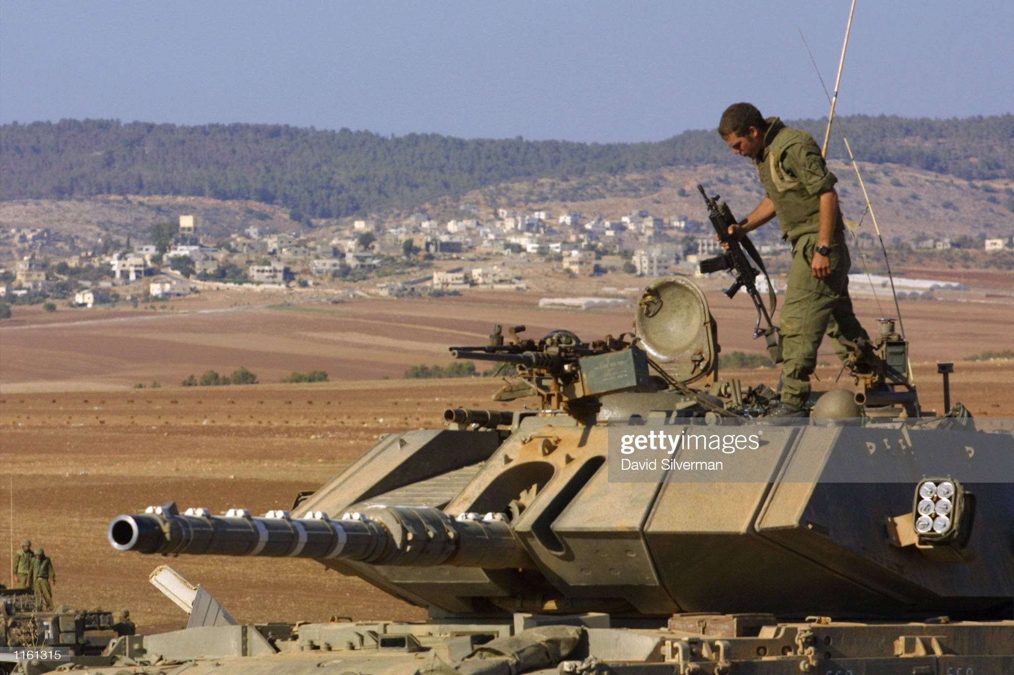 https://media.gettyimages.com/photos/an-israeli-soldier-stands-on-his-tanks-turret-on-the-outskirts-of-the-picture-id1161315?s=2048x2048