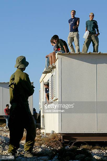 An Israeli soldier waits for orders to evacuate rightwing Jewish settlers who occupy a mobile home to thwart attempts by the army to dismantle the...
