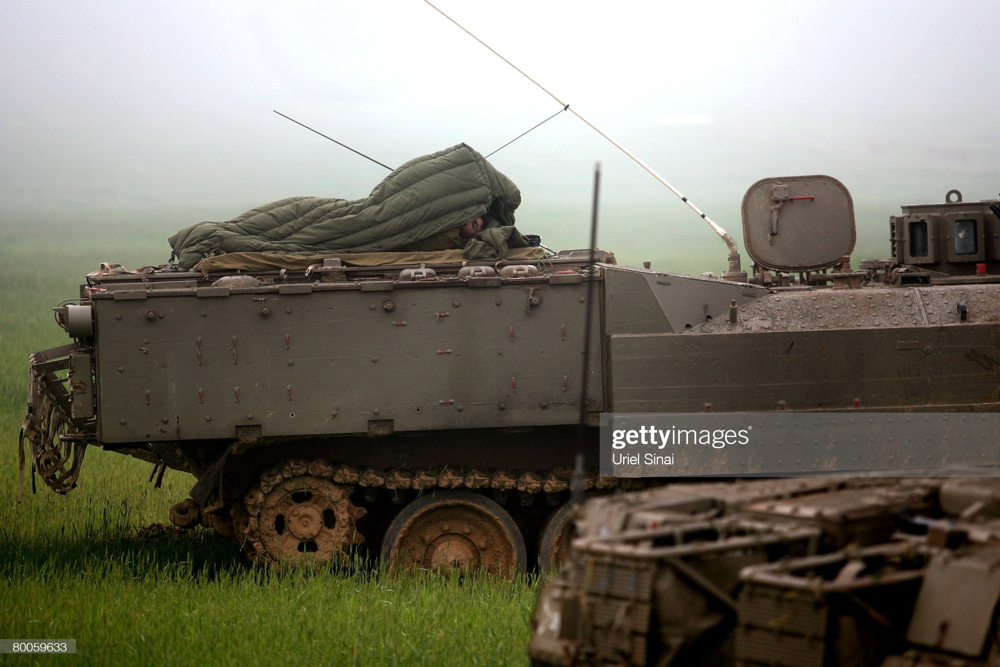 https://media.gettyimages.com/photos/an-israeli-soldier-wakes-up-on-top-of-a-tank-on-the-israeli-side-of-picture-id80059633?s=2048x2048