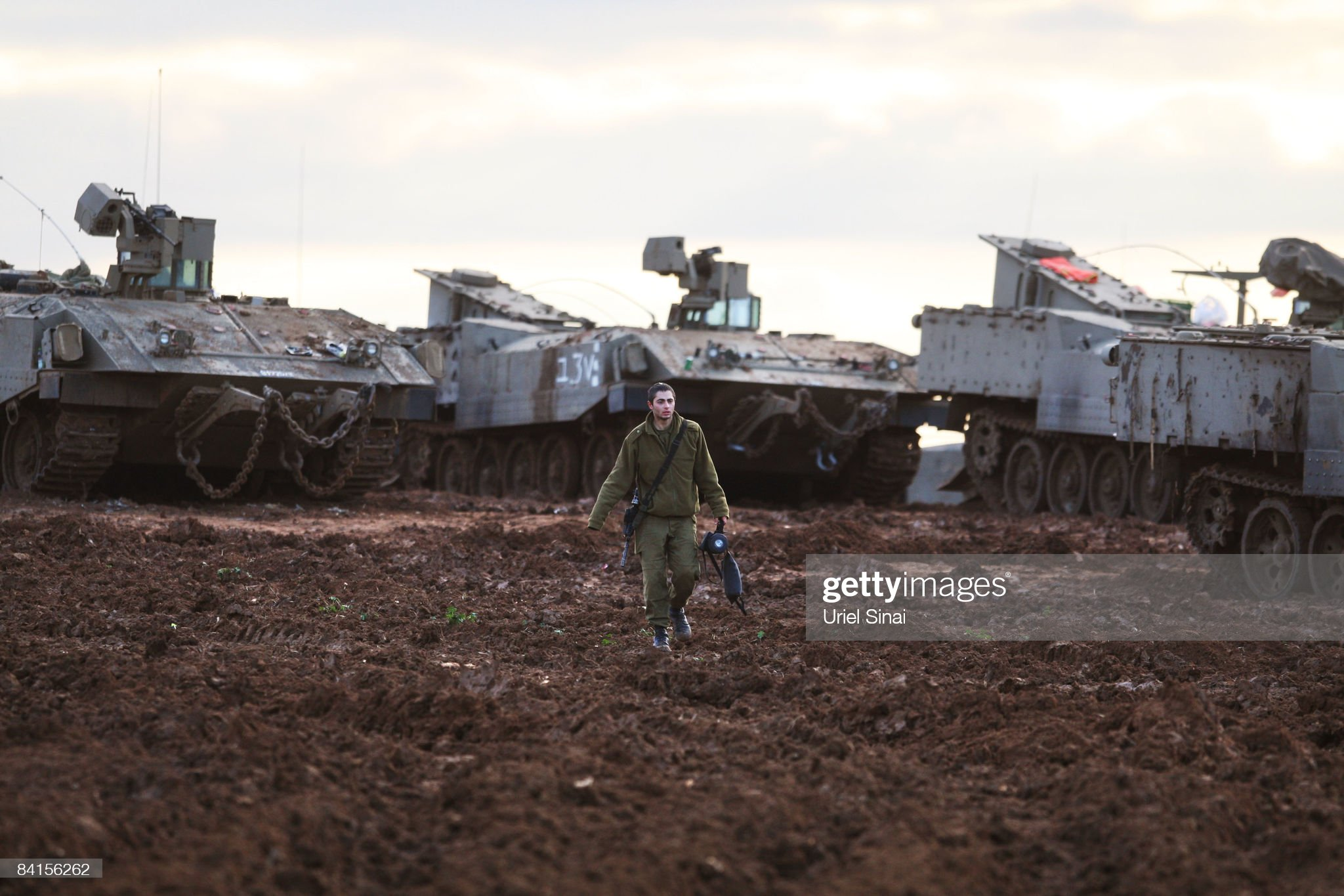 an-israeli-soldier-walks-near-his-units-tanks-at-a-forward-deployment-picture-id84156262?s=2048x2048