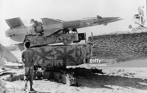 An Israeli soldier walks towards a Soviet-built Egyptian SAM III anti-aircraft missile launcher captured on the western bank of the Suez Canal during...
