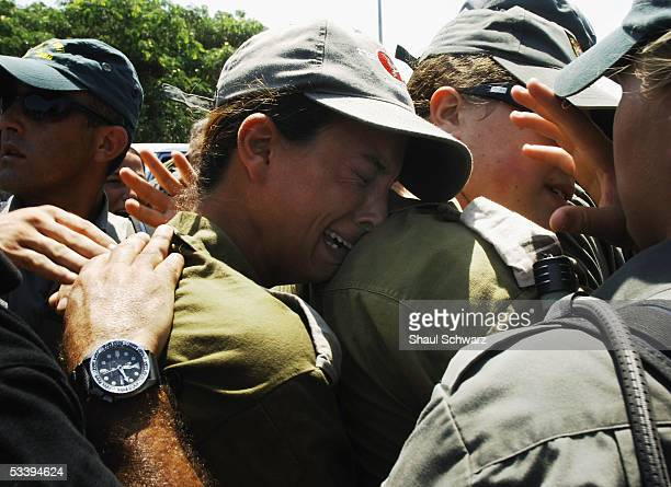 An Israeli solider cries as Israeli police clash with antidisengagement activists trying to prevent the entry of shipping containers August 16 2005...