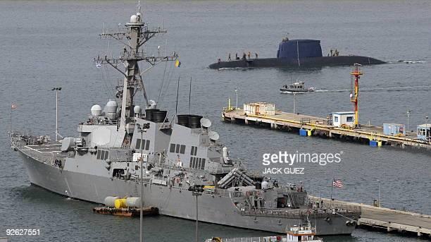 An Israeli submarine sails near US Navy war ship USS Decatur at Israel�s navy port in the Mediterranean city of Haifa on October 21 2009 Israel and...