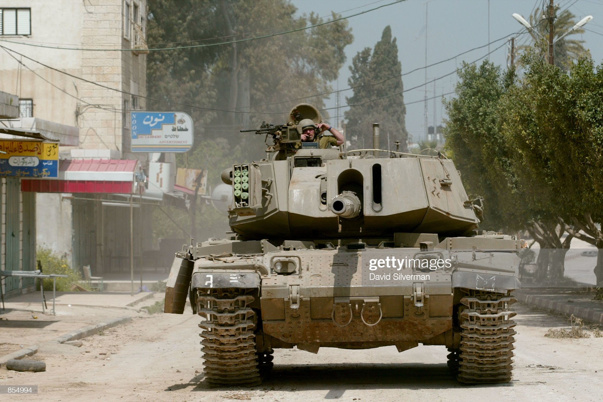 https://media.gettyimages.com/photos/an-israeli-tank-advances-down-a-main-road-in-the-west-bank-town-of-picture-id854994?s=2048x2048