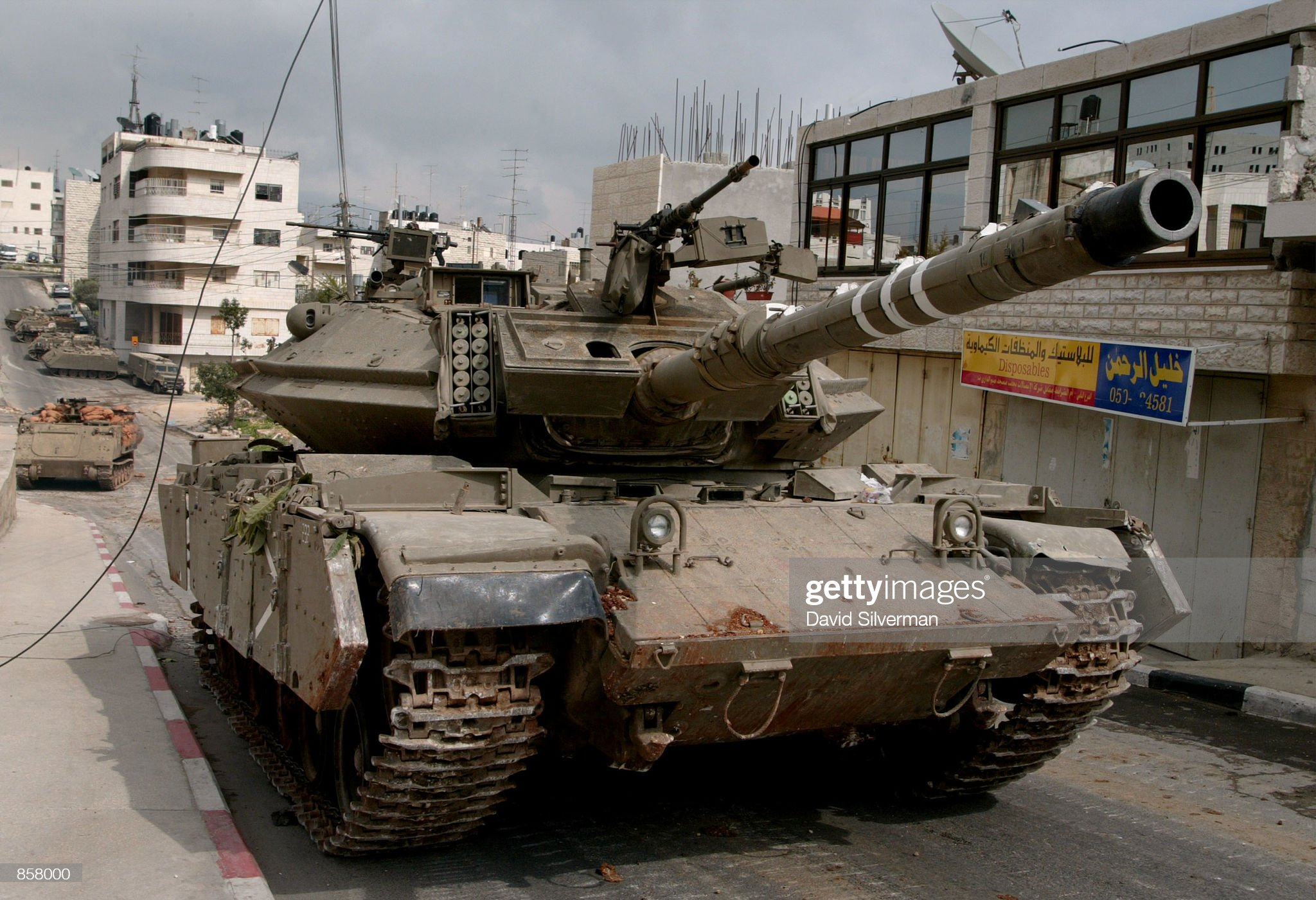 https://media.gettyimages.com/photos/an-israeli-tank-advances-up-a-residential-street-during-fighting-with-picture-id858000?s=2048x2048