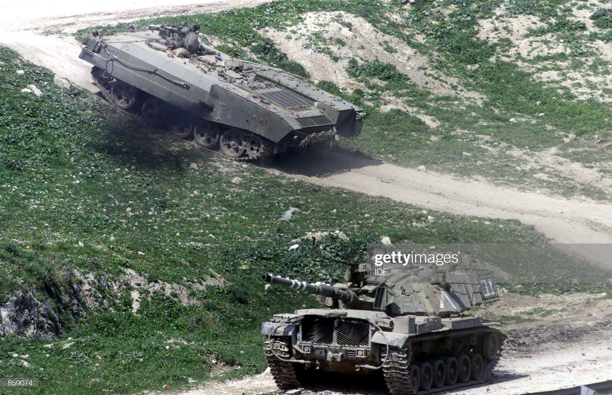 https://media.gettyimages.com/photos/an-israeli-tank-and-an-armored-personnel-carrier-enter-the-west-bank-picture-id859074?s=2048x2048