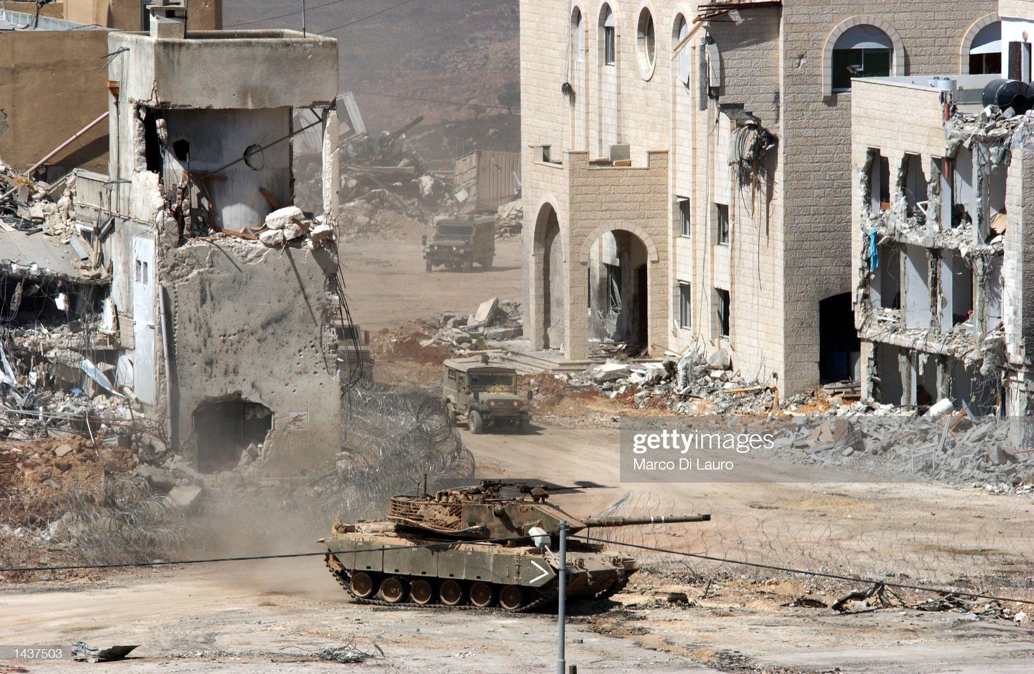 https://media.gettyimages.com/photos/an-israeli-tank-and-two-jeeps-drive-away-from-palestinian-leader-picture-id1437503?s=2048x2048
