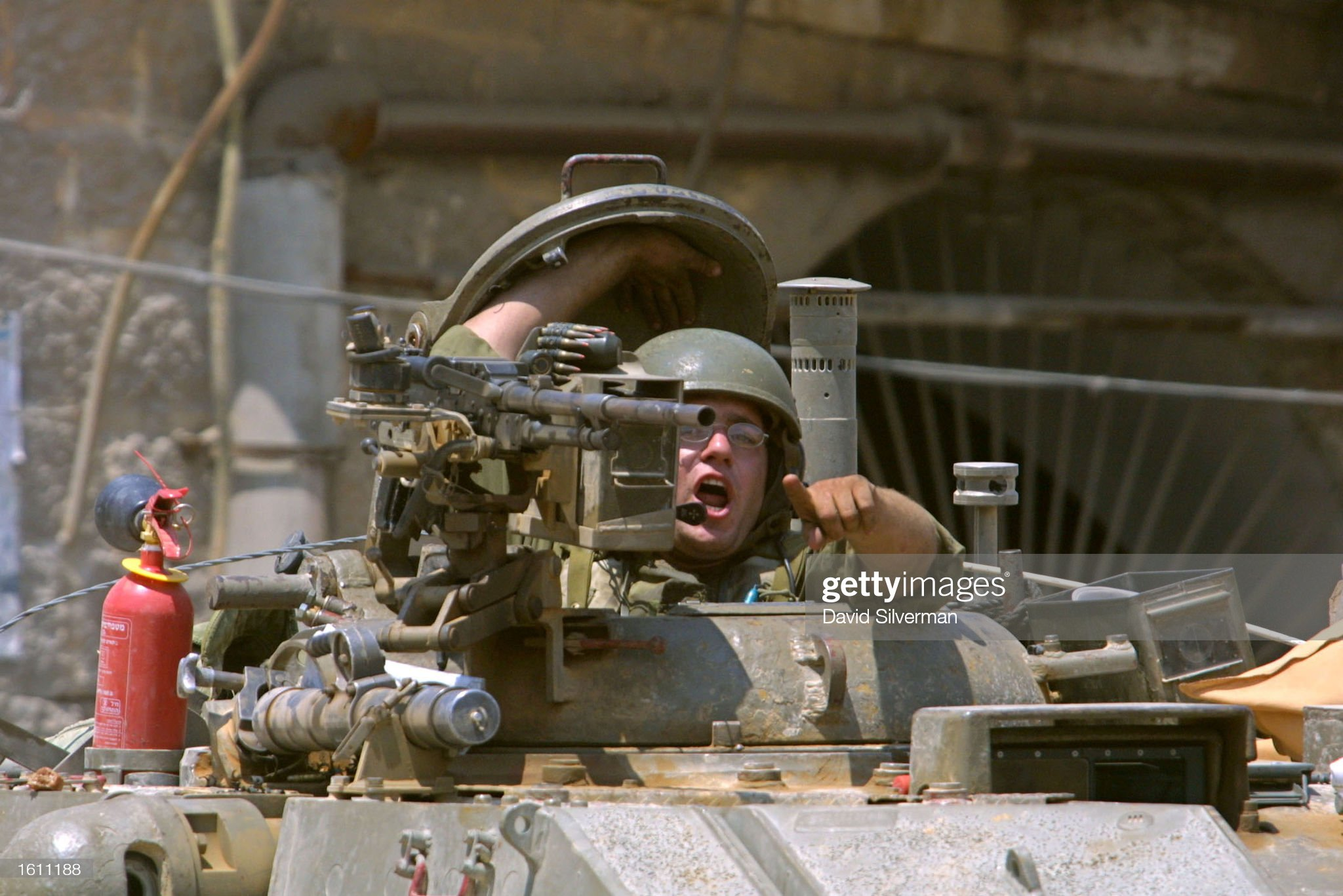 https://media.gettyimages.com/photos/an-israeli-tank-commander-orders-journalists-to-leave-the-area-before-picture-id1611188?s=2048x2048