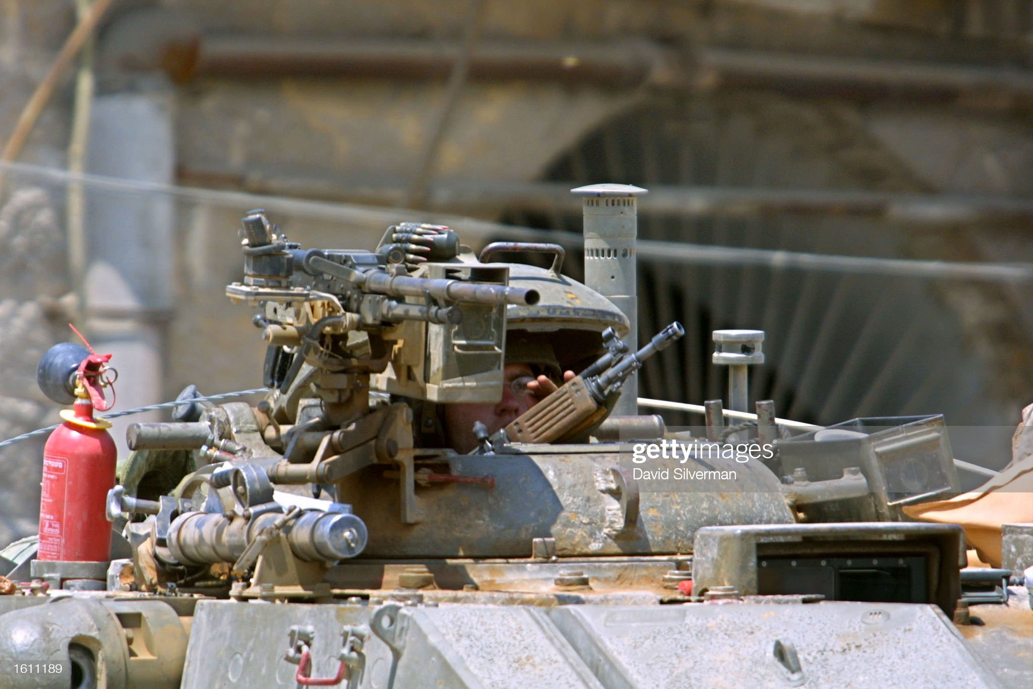 https://media.gettyimages.com/photos/an-israeli-tank-commander-peers-out-his-turret-during-an-exchange-of-picture-id1611189?s=2048x2048
