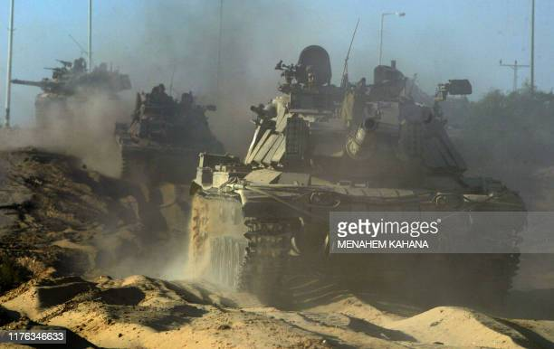 An Israeli tank convoy towards the outskirts of the southern Gaza Strip town of Rafah 20 May 2004, on the third day of the massive Israeli army...