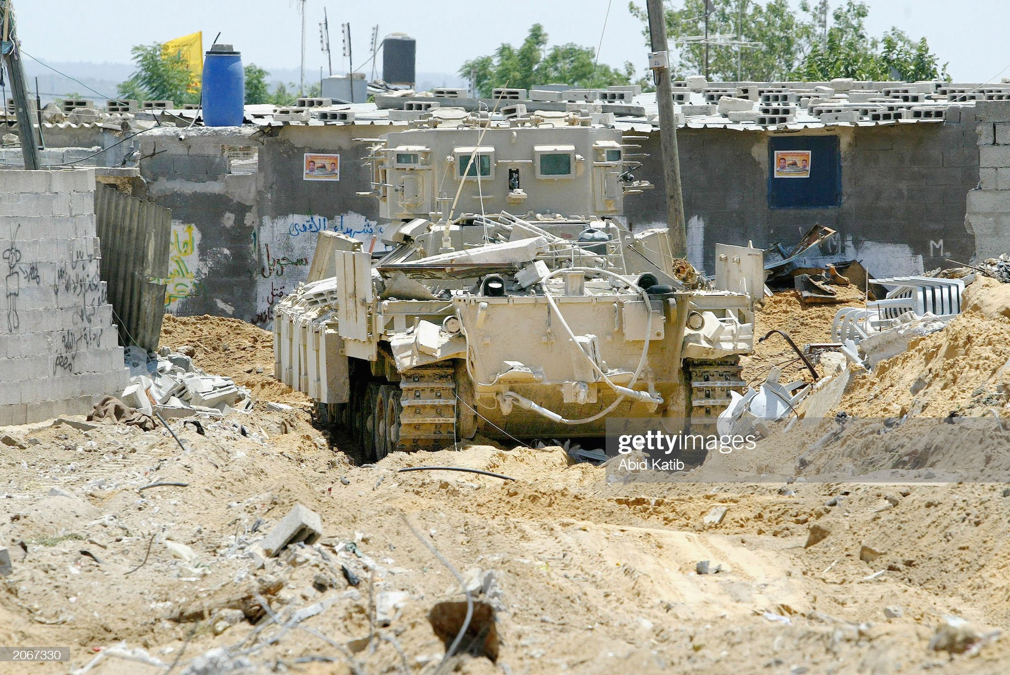 https://media.gettyimages.com/photos/an-israeli-tank-destroys-the-family-home-of-mousa-sehwel-a-member-of-picture-id2067330?s=2048x2048