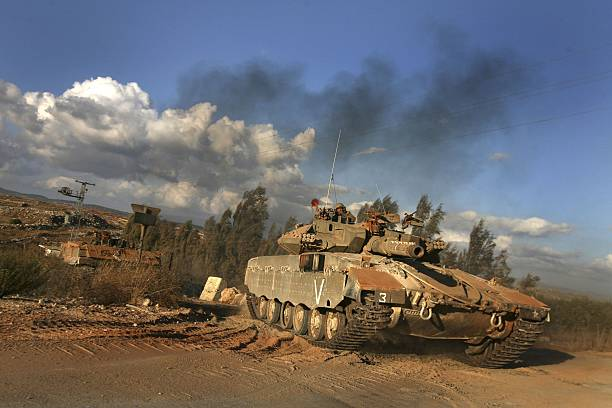 an israeli tank drives along the border on september 21 2006 near the israeli
