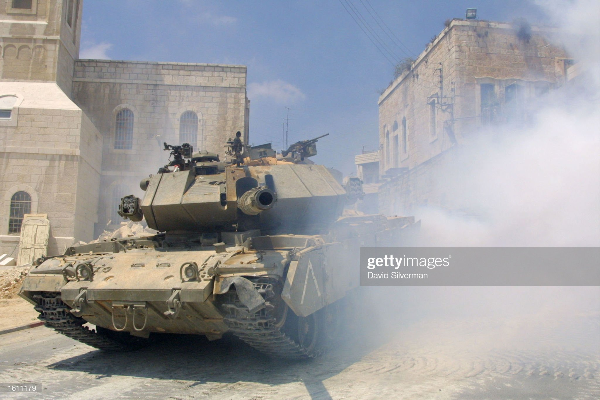 https://media.gettyimages.com/photos/an-israeli-tank-emerges-from-a-smoke-screen-as-it-changes-position-a-picture-id1611179?s=2048x2048