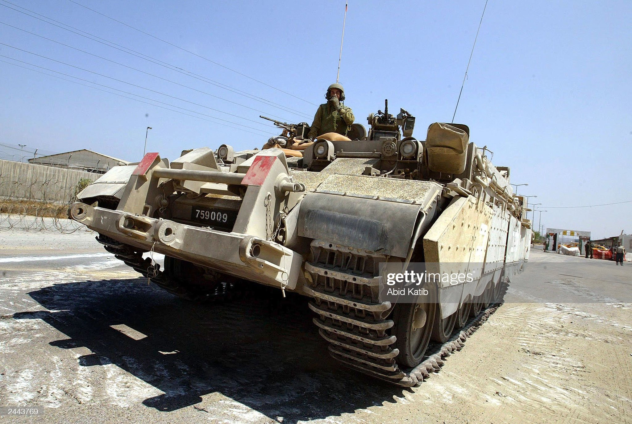 https://media.gettyimages.com/photos/an-israeli-tank-enters-the-israelipalestinian-erez-checkpoint-august-picture-id2443769?s=2048x2048
