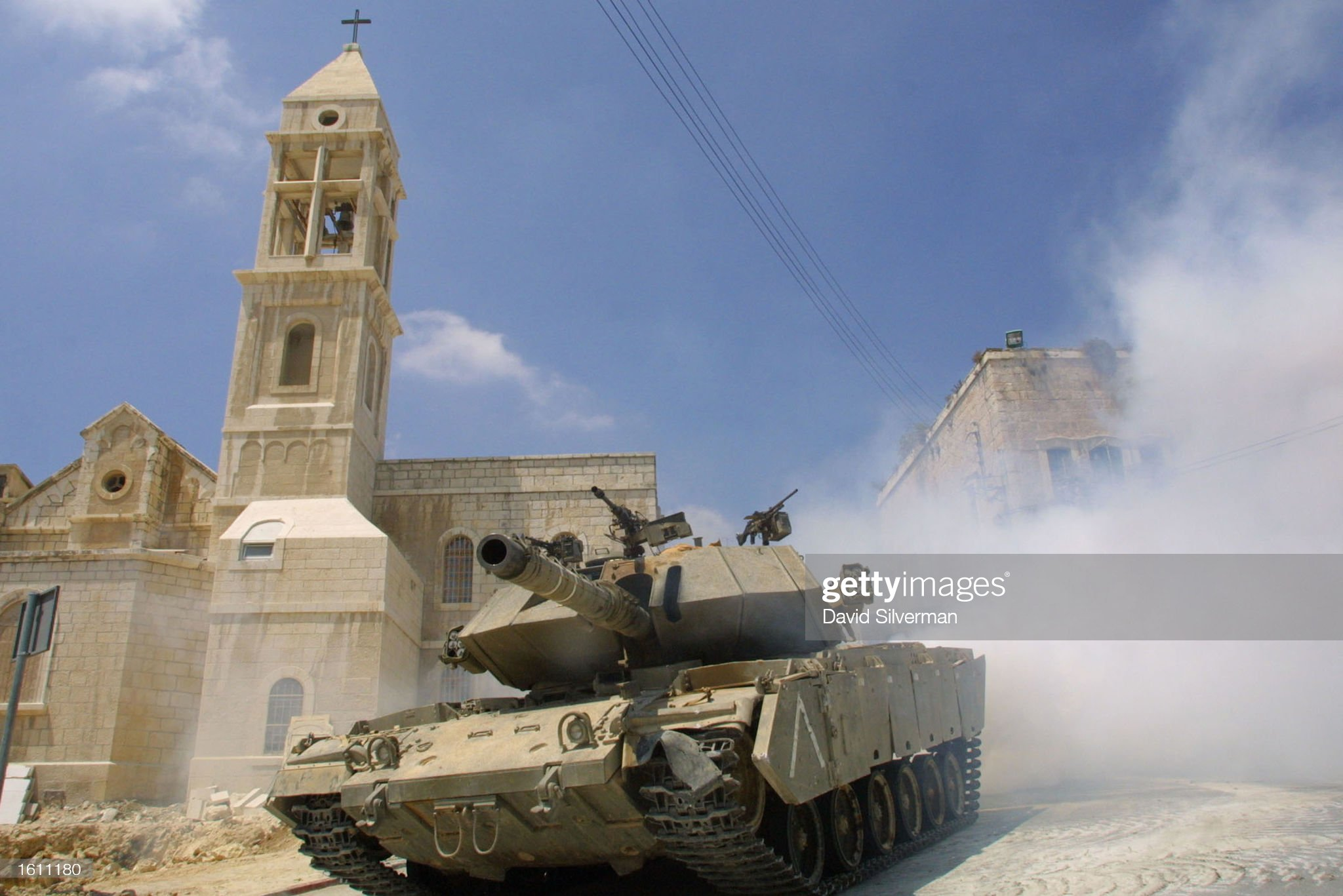 https://media.gettyimages.com/photos/an-israeli-tank-gives-itself-a-smoke-screen-as-it-changes-position-a-picture-id1611180?s=2048x2048