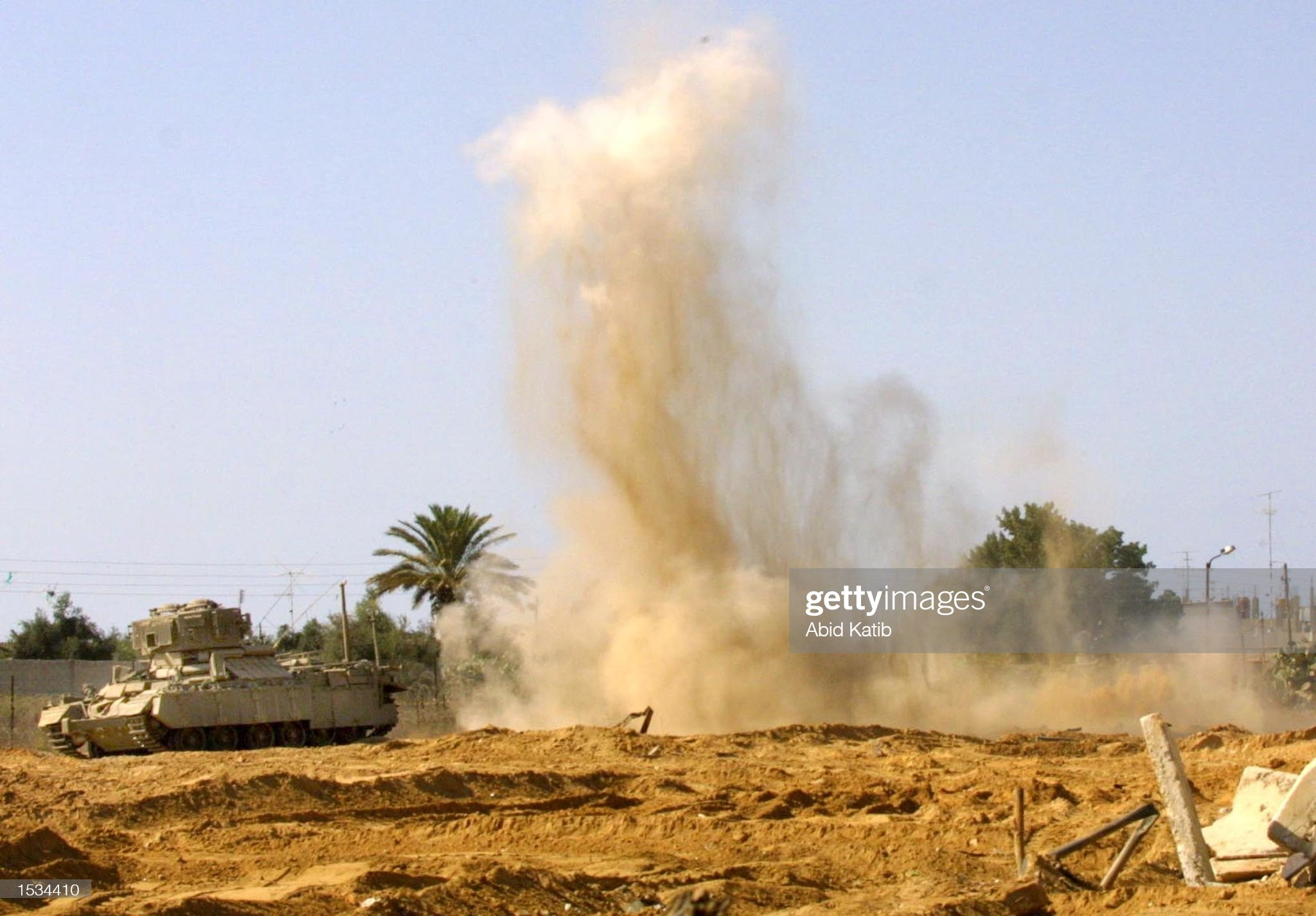 https://media.gettyimages.com/photos/an-israeli-tank-guards-as-israeli-forces-blow-up-a-tunnel-october-26-picture-id1534410?s=2048x2048