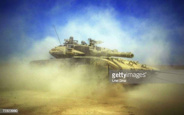 An Israeli tank is pictured at the border between Kibbutz Mefalsim and the Gaza Strip on October 3 2004 in Gaza Strip Israeli Prime Minister Ariel...