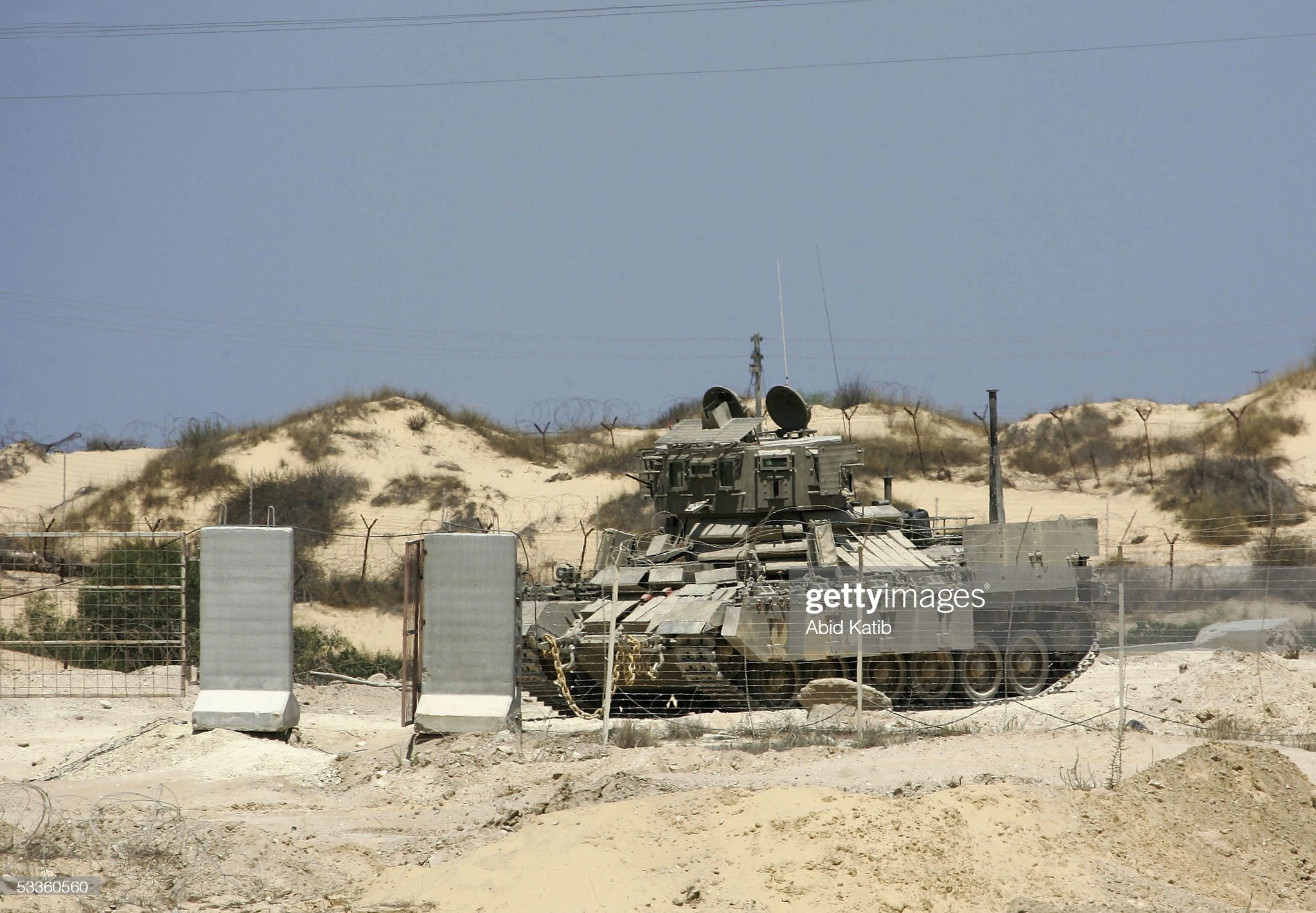 https://media.gettyimages.com/photos/an-israeli-tank-is-pictured-in-front-the-jewish-settlement-of-rafiah-picture-id53360560?s=2048x2048