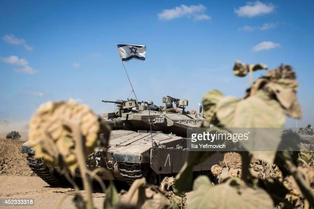 An Israeli tank maneuvers at the border with Gaza on July 18 2014 near Sderot Israel Late last night Israeli forces escalated their operation with a...