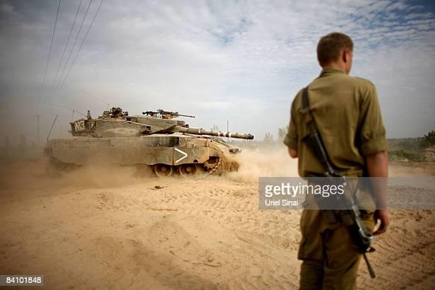 An Israeli tank maneuvers during a deployment near the Israeli border with Gaza on December 21 2008 near kibbutz Kisufim Israel A sixmonth ceasefire...