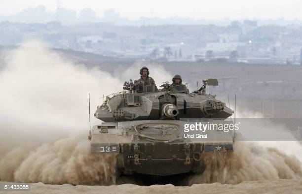 An Israeli tank moves out, on October 6, 2004 near Kibbutz Mefalsim, Gaza Strip. Israeli troops are pressing ahead with a major offensive in Gaza for...