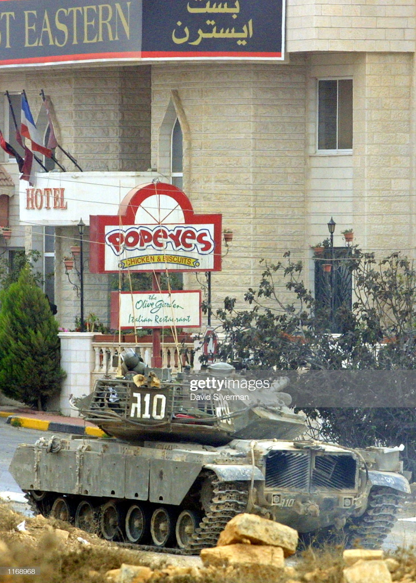 https://media.gettyimages.com/photos/an-israeli-tank-passes-a-hotel-as-it-changes-position-october-18-2001-picture-id1168968?s=2048x2048