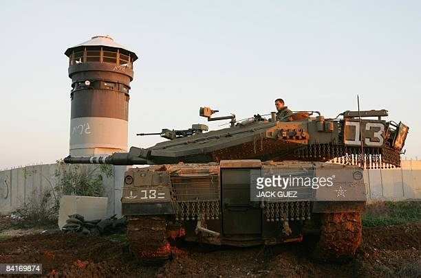 An Israeli tank patrols along the Israeli border with the Gaza Strip on January 5 2009 Israeli troops and Hamas fighters battled in Gaza today amid...