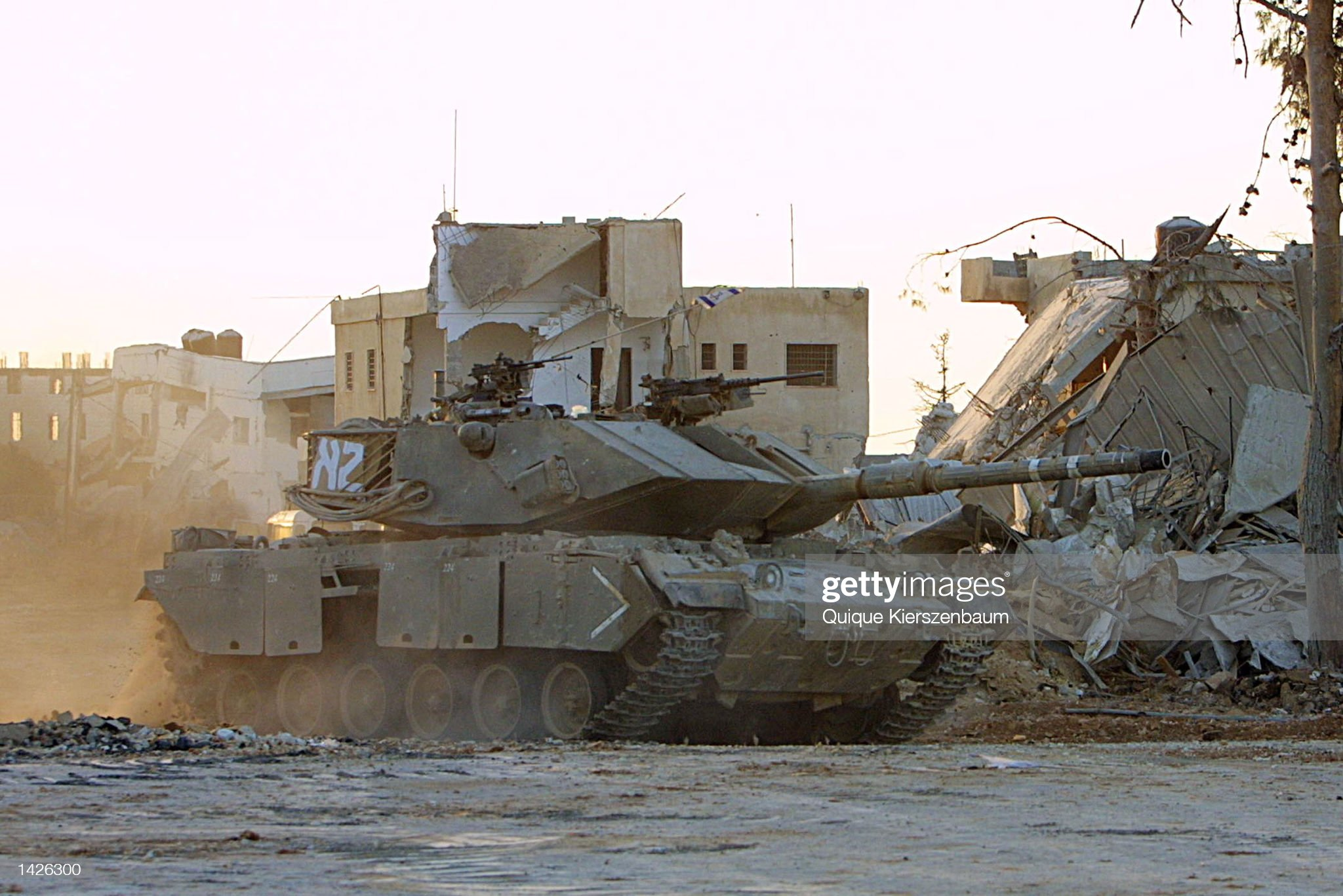 https://media.gettyimages.com/photos/an-israeli-tank-patrols-around-the-battered-buildings-of-palestinian-picture-id1426300?s=2048x2048