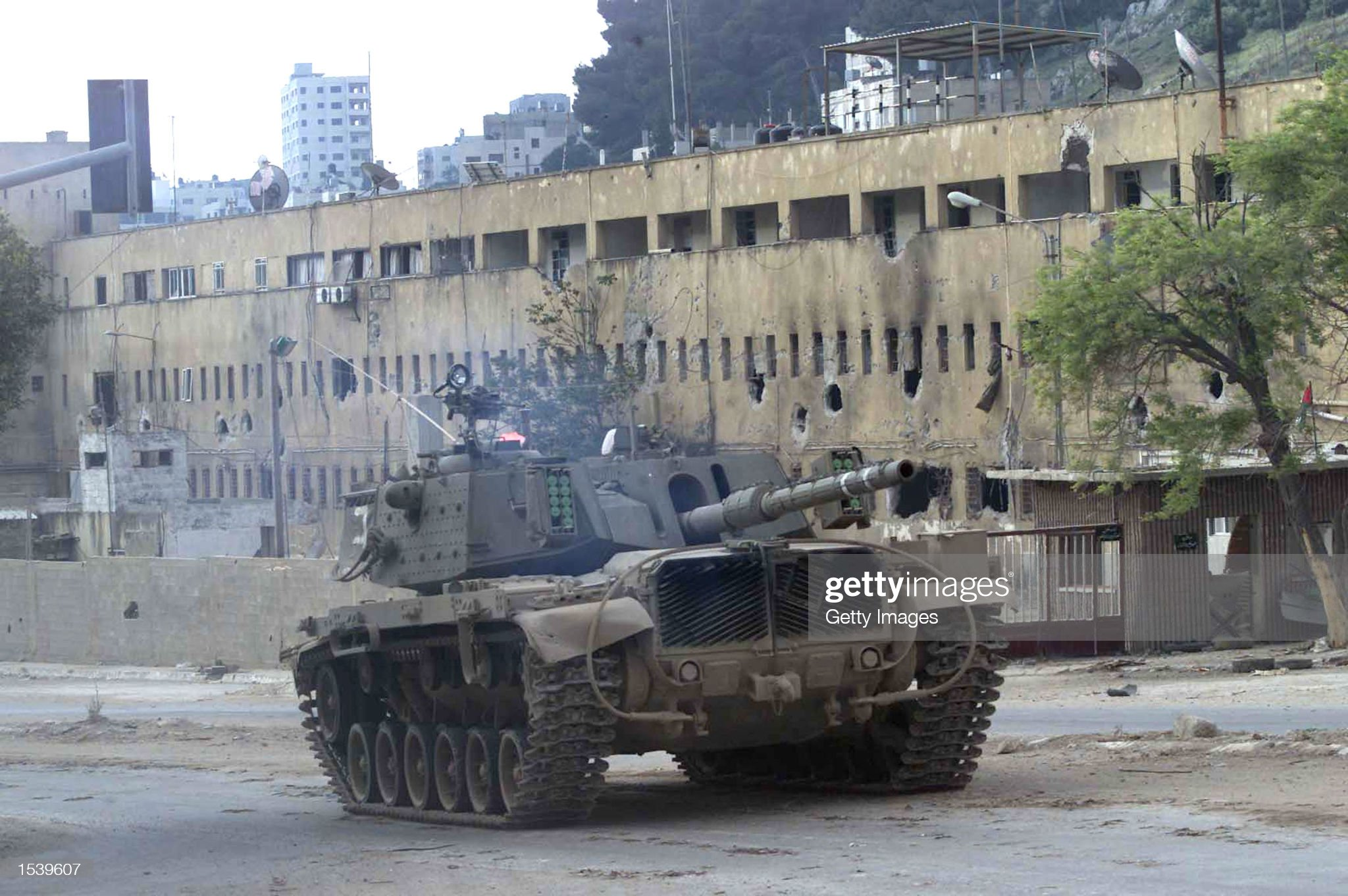 https://media.gettyimages.com/photos/an-israeli-tank-patrols-may-3-2002-in-the-west-bank-city-of-nablus-an-picture-id1539607?s=2048x2048