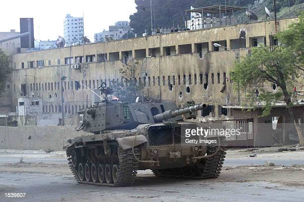 An Israeli tank patrols May 3 2002 in the West Bank city of Nablus An Israeli soldier and two Palestinians were killed in the fighting when Israeli...