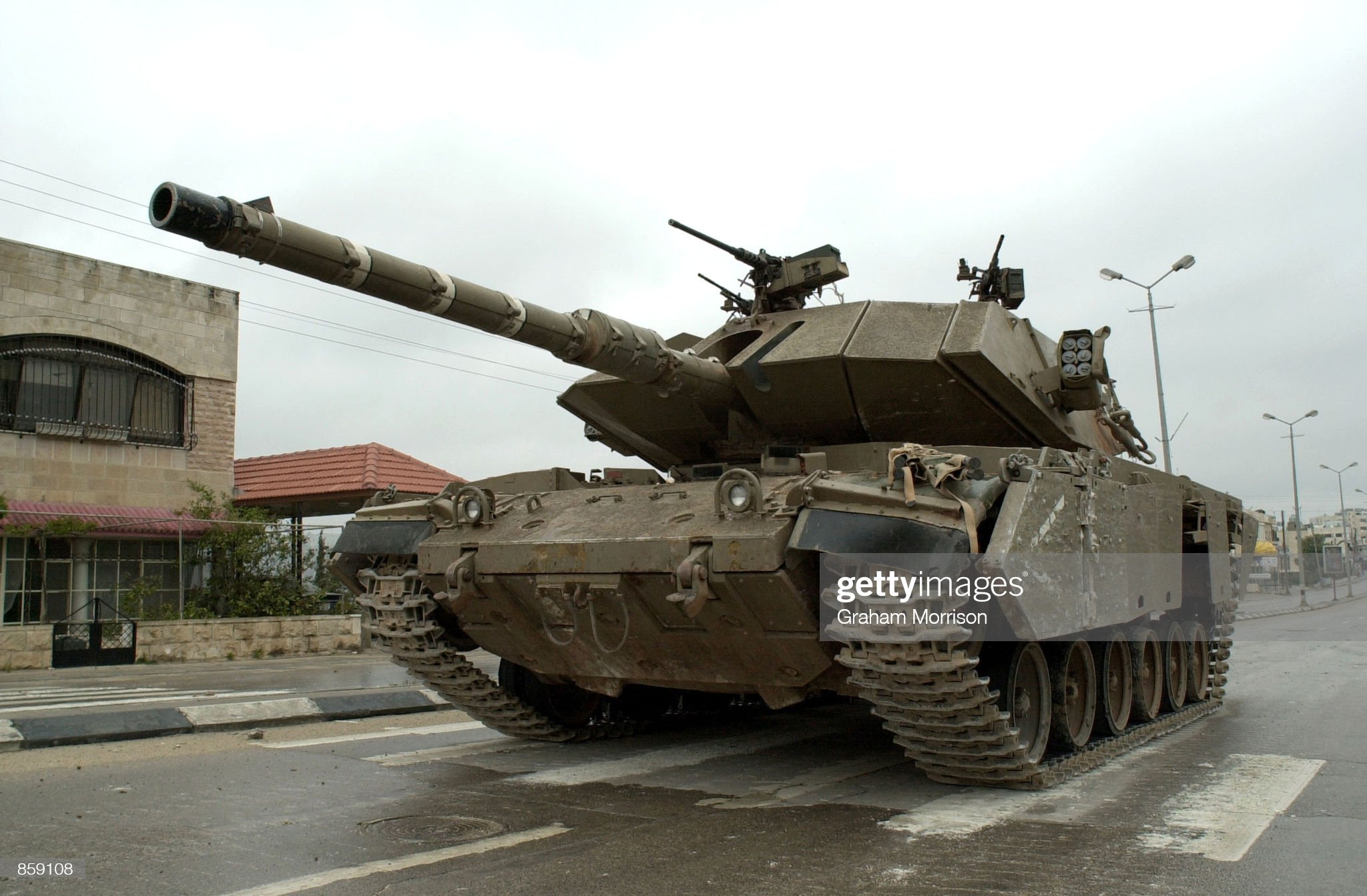 https://media.gettyimages.com/photos/an-israeli-tank-pauses-on-hebron-road-which-divides-the-west-bank-of-picture-id859108?s=2048x2048