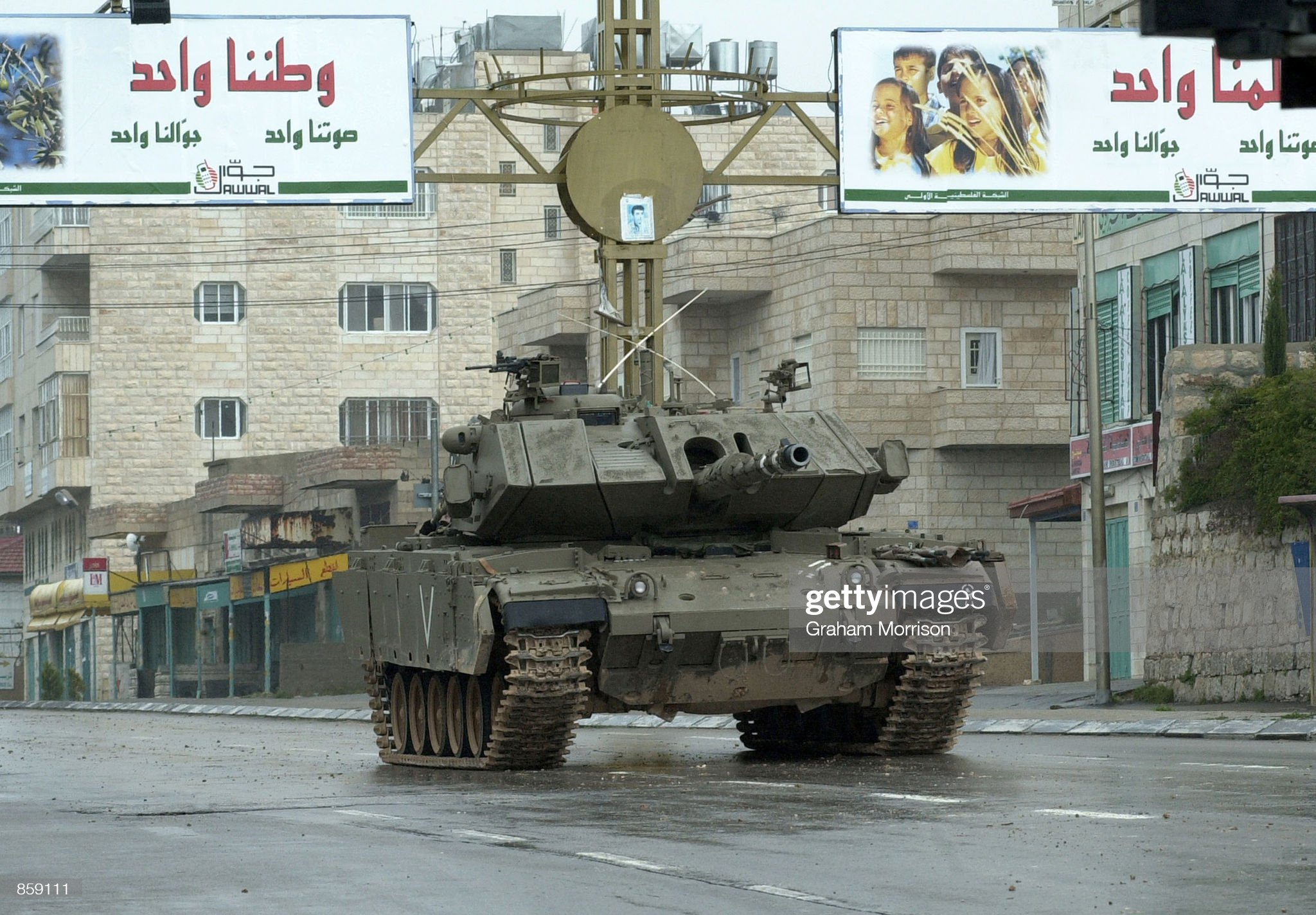https://media.gettyimages.com/photos/an-israeli-tank-pauses-on-hebron-road-which-divides-the-west-bank-of-picture-id859111?s=2048x2048