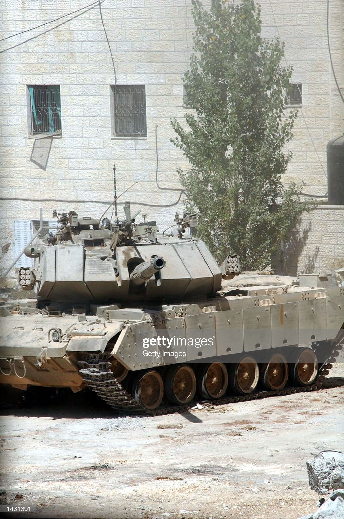 https://media.gettyimages.com/photos/an-israeli-tank-points-its-canon-at-palestinian-leader-yasser-arafats-picture-id1431391?s=2048x2048