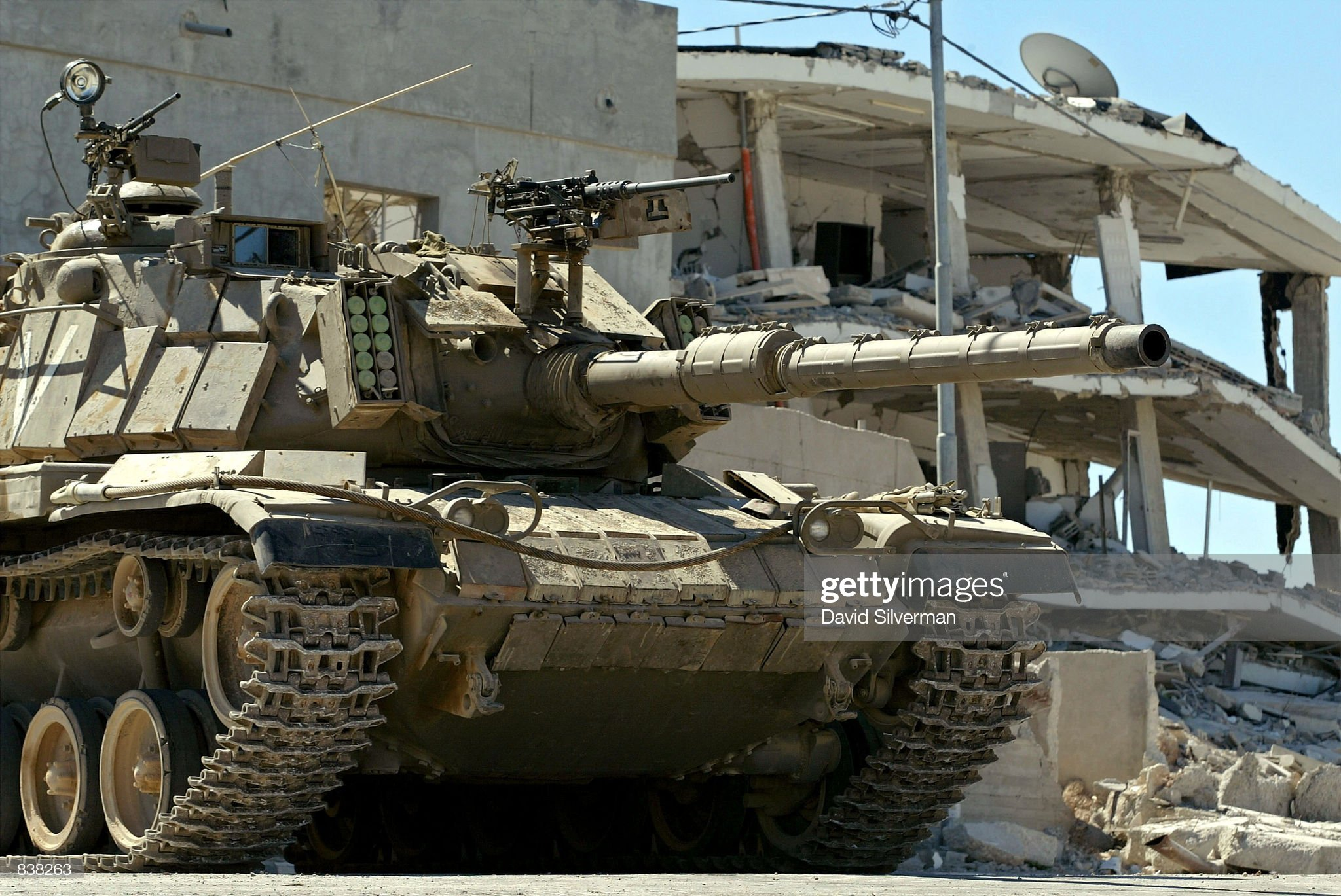 https://media.gettyimages.com/photos/an-israeli-tank-stands-guard-outside-palestinian-leader-yasser-june-picture-id838263?s=2048x2048