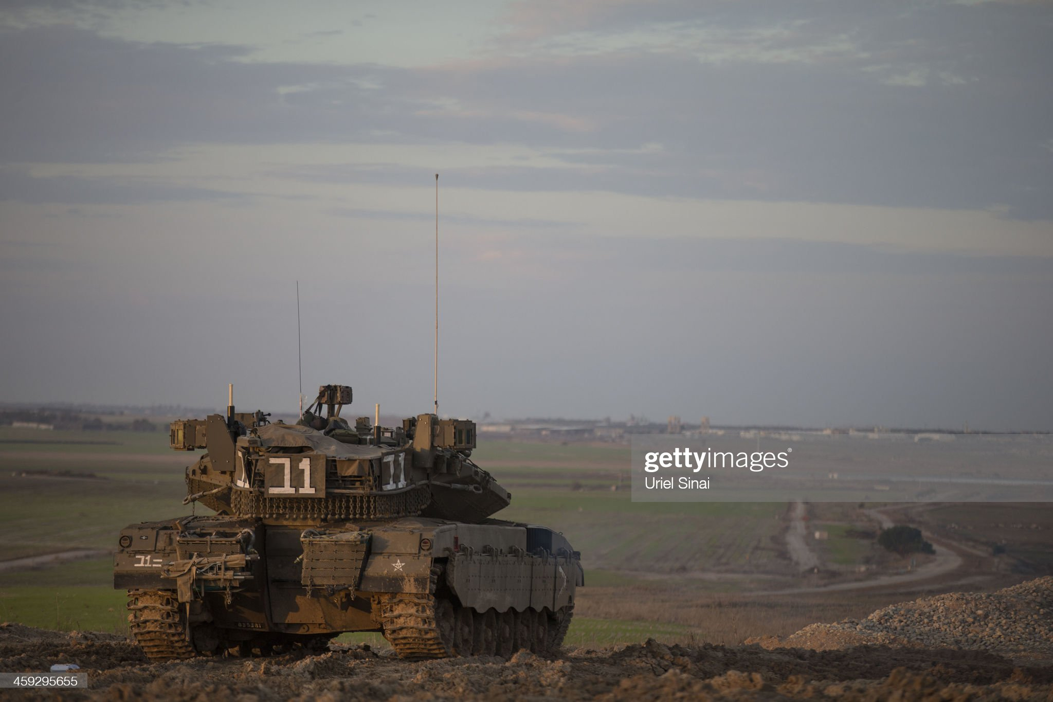 https://media.gettyimages.com/photos/an-israeli-tank-takes-a-position-on-december-25-2013-along-the-with-picture-id459295655?s=2048x2048