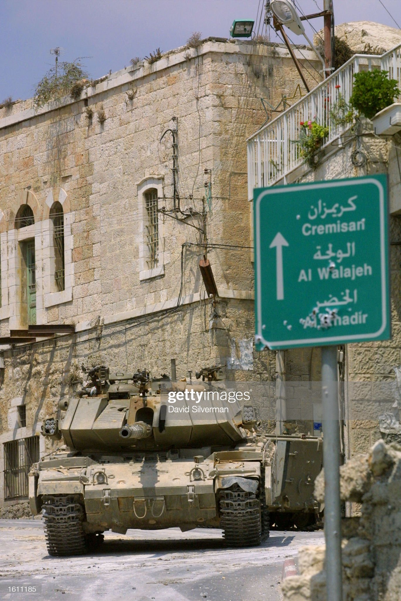 https://media.gettyimages.com/photos/an-israeli-tank-takes-up-position-august-28-2001-in-the-middle-of-the-picture-id1611185?s=2048x2048
