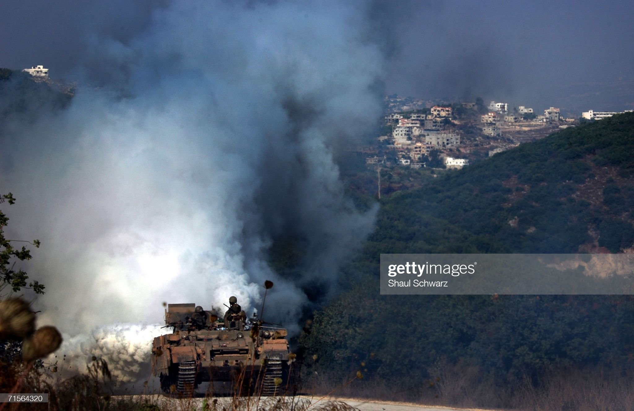 https://media.gettyimages.com/photos/an-israeli-tank-uses-a-smoke-screen-to-protect-itself-from-anti-tank-picture-id71564320?s=2048x2048