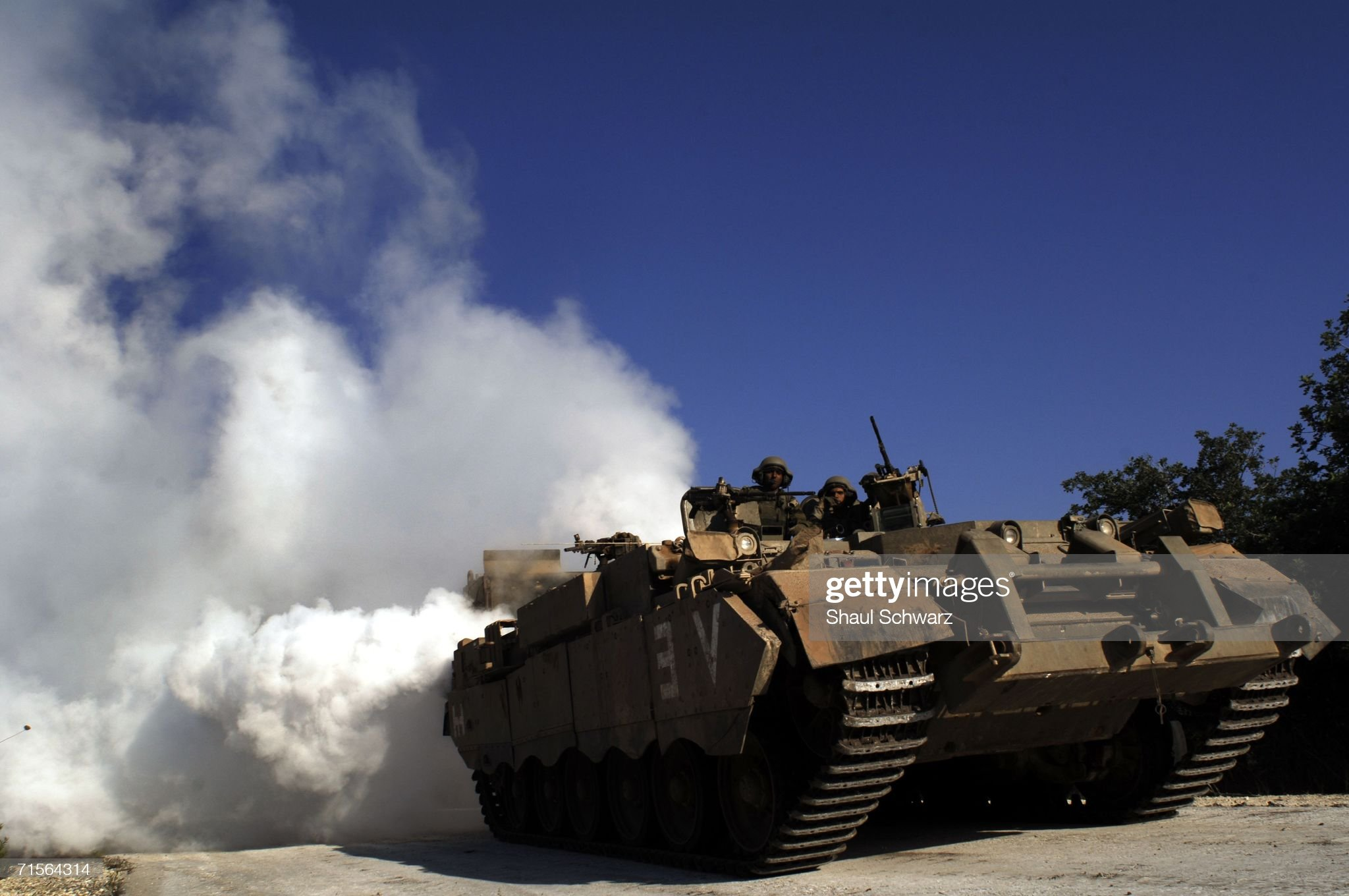 https://media.gettyimages.com/photos/an-israeli-tank-uses-smoke-grenades-to-protect-itself-from-anti-tank-picture-id71564314?s=2048x2048