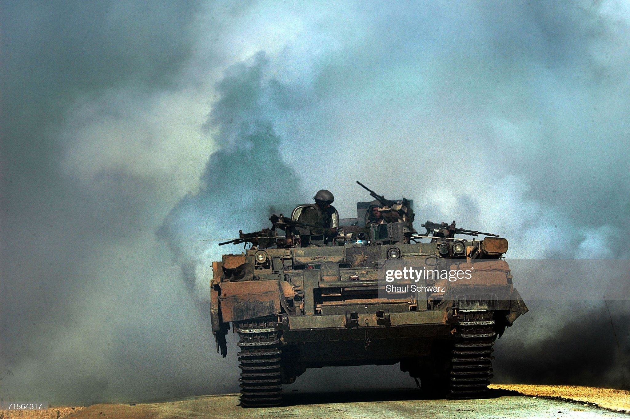 https://media.gettyimages.com/photos/an-israeli-tank-uses-smoke-grenades-to-protect-itself-from-anti-tank-picture-id71564317?s=2048x2048