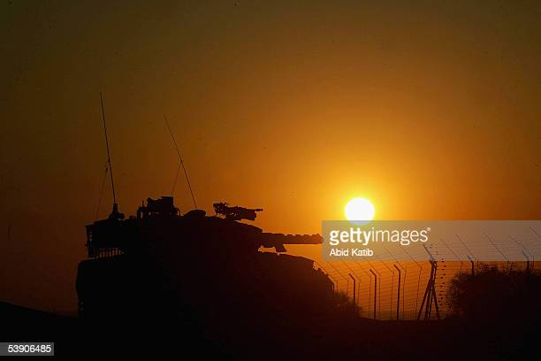 An Israeli tanks guards the vacant Jewish settlement of Neve Dekalim on September 1, 2005 in the southern Gaza Strip. According to reports from...