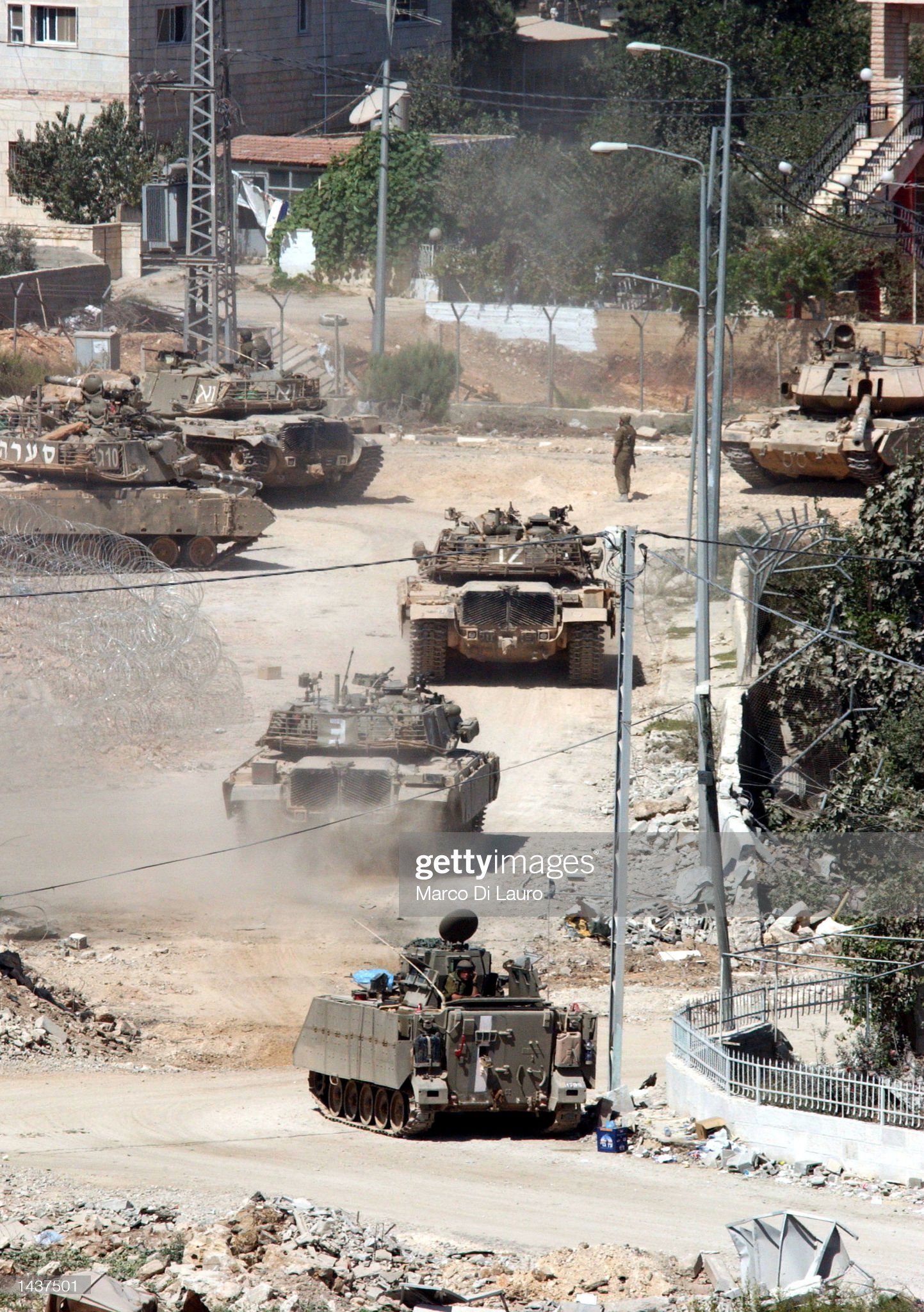 https://media.gettyimages.com/photos/an-israeli-tanks-line-up-outside-palestinian-leader-yasser-arafats-picture-id1437501?s=2048x2048